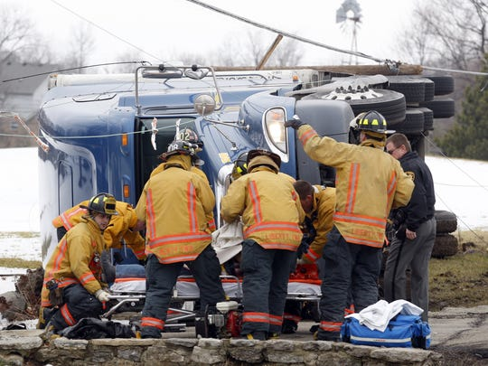 Members of the Liberty Township Fire Department free the driver of a semi truck after crashing into a utility pole on Princeton Road west of Ohio 747 in Liberty Township in 2010. Township officials say the work will make Princeton Road safer.