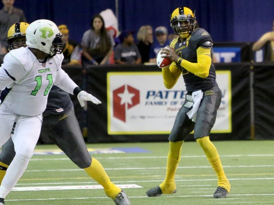 Wichita Falls Nighthawks' Charles McCullum looks for an open reciever in the game against the Nebraska Danger Friday, May 5, 2017, in Kay Yeager Coliseum. The Nighthawks defeated the Danger 57-40.