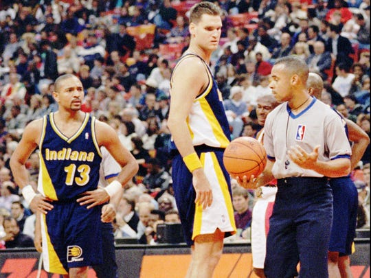 Dwayne Schintzius (55) looks disapprovingly at replacement referee Anthony Jordan in 1995. The talented college big man spent one season with the Pacers.