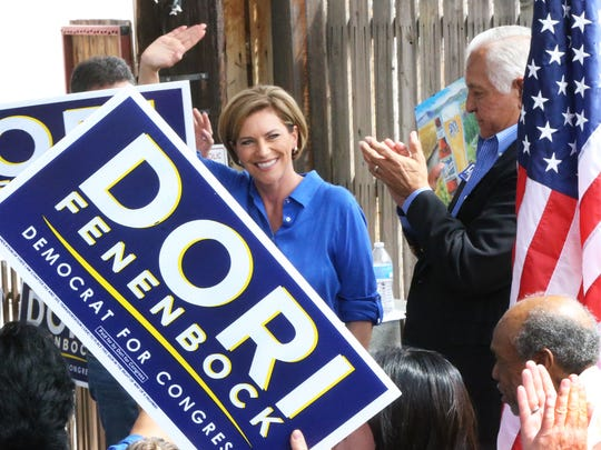 Dori Fenenbock waves to the crowd after speaking at an event in September in which she announced her run for Congress. At right is former U.S. Rep. Silvestre Reyes, who introduced Fenenbock.