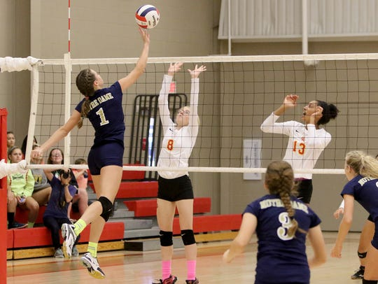 Notre Dame's Reagan Macha hits the ball over Christ