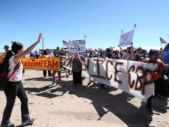 Marchers arrive at the entrance to the Tornillo-Guadalupe