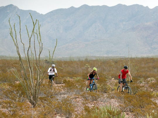 A trio of cyclists ride one of the trails in the Lost