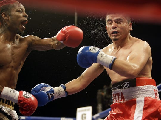 Rasheed Warren lands a punch during his victory at US Bank Arena.