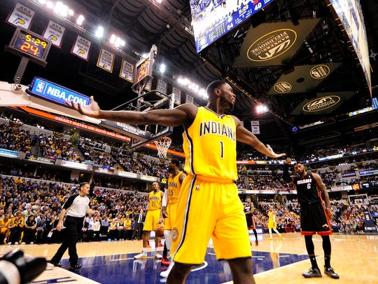 Indiana Pacers guard Lance Stephenson reacts to being called for a foul on Miami Heat forward LeBron James.