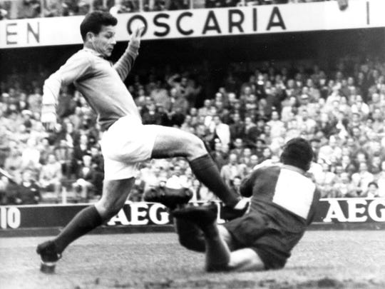 This is a June 24, 1958  file photo of France's Just Fontaine, left, as he tries to go past  Brazil's goalkeeper Gilmar tackles in their semifinal match in Stockholm.
