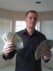 Ian Wallace of Rancho Murieta, Calif. holding some