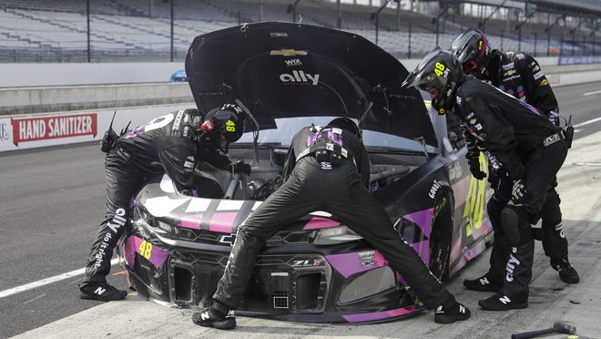 The crew for race driver Justin Allgaier works on the car on a pit stop during the NASCAR Cup Series auto race at Indianapolis Motor Speedway in Indianapolis, Sunday.