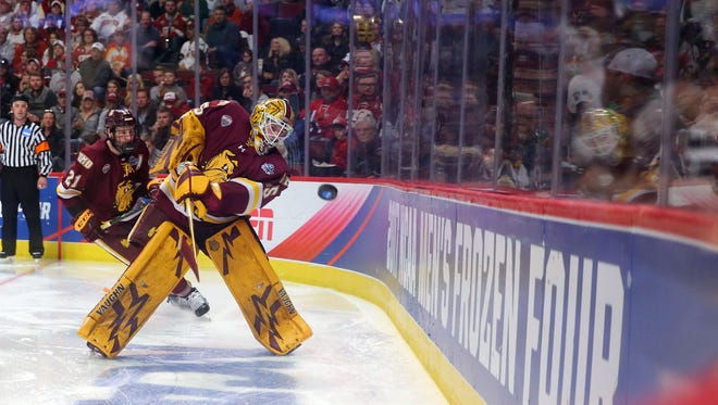Apr 8, 2017; Chicago, IL, USA; Minnesota-Duluth Bulldogs goalie Hunter Miska (35) moves the puck around the board during the second period of play during the championship game of the 2017 Frozen Four against the Denver Pioneers at United Center.