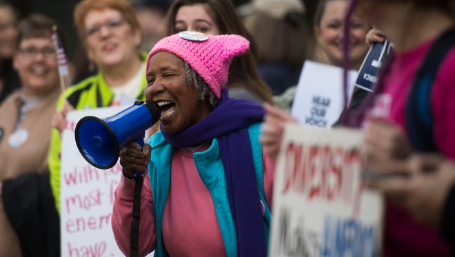 Jacqueline Hill, of Alcoa leads attendees of the Knoxville Women's March in a chant at Krutch park in downtown Knoxville Sunday, Jan. 21, 2018 . The crowd attending the march grew to 10,000 and spanned 10 blocks.