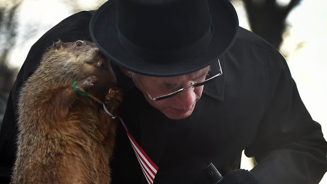 Donald Hickernell receives Uni the groundhog on stage at Myerstown Community Park.