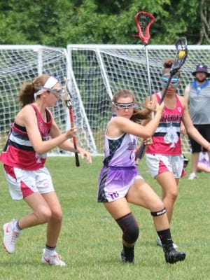 Zoe Weber (right) carries the ball for Plymouth-based Triumph Lacrosse. She is attending the National Lacrosse Academy/Classic later this month in Richmond, Virginia.