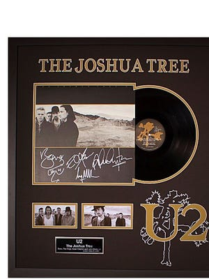 """A framed album of U2's The Joshua Tree, autographed by the entire band, also is among the silent auction items at the """"Rock the Block for Pettway Park"""" party at 6 p.m. Nov. 10."""