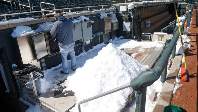 Snow in the the Minnesota Twins' dugout at Target Field in Minneapolis on Wednesday.
