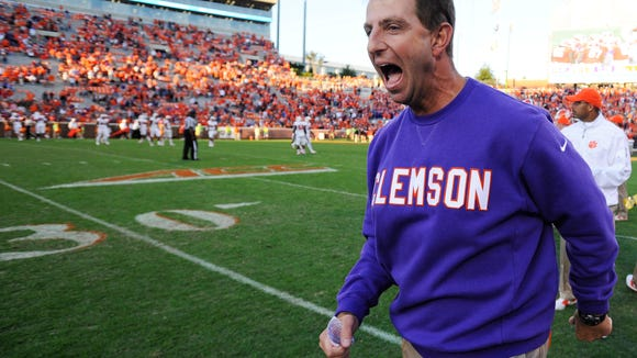 """AP """"I don't sit around and play hypotheticals or 'What ifs' or whatever,"""" said Clemson coach Dabo Swinney, whose team takes on Louisville on Saturday. Clemson head coach Dabo Swinney reacts after defeating North Carolina State 41-0 in an NCAA college football game, Saturday, Oct. 4, 2014, in Clemson, S.C. (AP Photo/Rainier Ehrhardt)"""