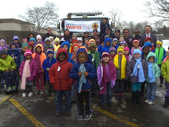 Farmington Hills firefighters visited Lanigan Elementary with new coats, hats and scarves.