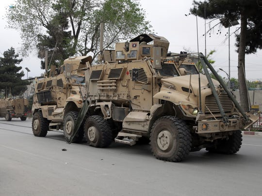 """In this May 3 , 2017 file photo, A damaged U.S. military vehicle is pictured at the site of a suicide attack in Kabul, Afghanistan. In an """"open letter"""" to U.S. President Donald Trump, Afghanistan's Taliban on Tuesday reiterated their call for a withdrawal of troops to end the protracted war."""