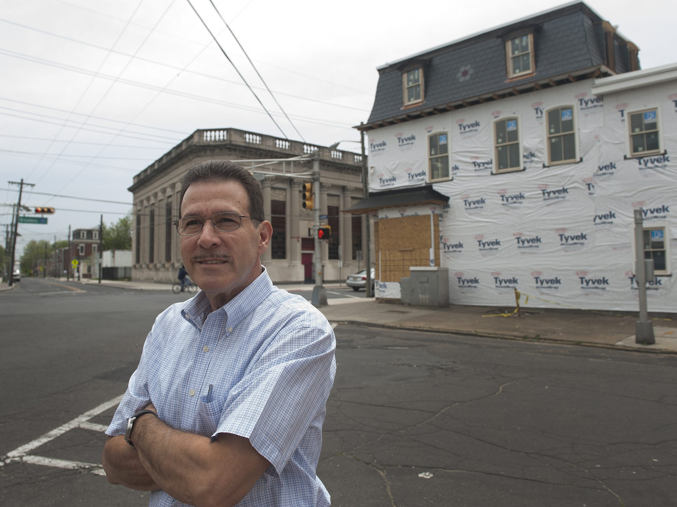 George Villianos of the Nick Virgilio Society stands in front  of the future writer's house in Camden named for poet Nick Virgilio and sponsored in part by Sacred Heart.