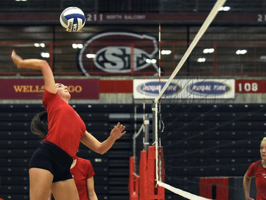 St. Cloud State volleyball player Macy Weller spikes