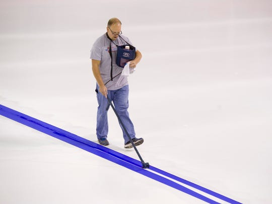 Mid America Rink Services owner Jeff Remelius of Kalamazoo, Mich., stripes the ice at the Ford Center where the Evansville Thunderbolts will open their season Oct. 22, 2016.