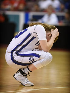 Falcon Alyssa Austin reacts after falling to Central