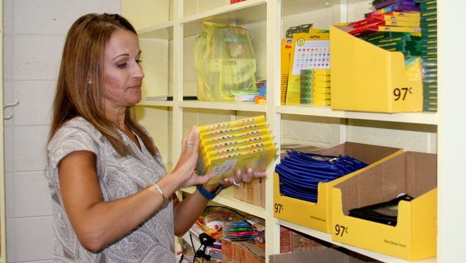 Jill Czanstkowski, facilitator of Bridges of Mountain Home, prepares items for the Back to School Bazaar on Friday, Aug. 3, at Nelson-Wilks-Herron Elementary School.