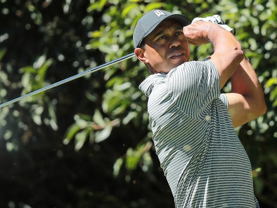 Tiger Woods plays his shot from the 2nd tee during