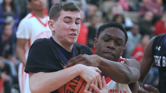 North Rockland's Carlens Vilfort (33) fights New Rochelle's Jake Armiento for a loose ball during a game at North Rockland High School.