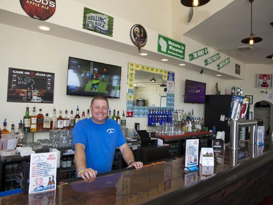 Dave Nennig stands by the bar at Harbor Lights Tavern Wednesday. Nennig has remodeled the establishment to give a nod to the building's long history.