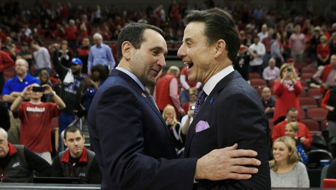 Matt Stone/The Courier-Journal Duke's Mike Krzyzewski and Louisville's Rick Pitino get together before Saturday?s game. Duke's Mike Krzyzewski and Louisville's Rick Pitino share a greeting before a game at the KFC Yum! Center. Feb. 20, 2016