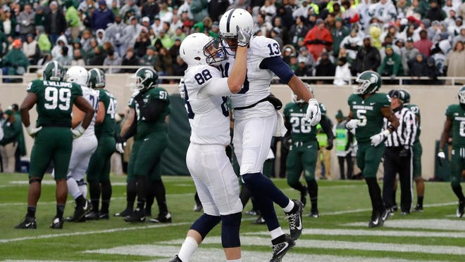 Penn State wide receiver Saeed Blacknall (13) is congratulated by tight end Mike Gesicki (88) after scoring a touchdown during the first half of an NCAA college football game against Michigan State, Saturday, Nov. 4, 2017, in East Lansing, Mich. (AP Photo/Carlos Osorio)