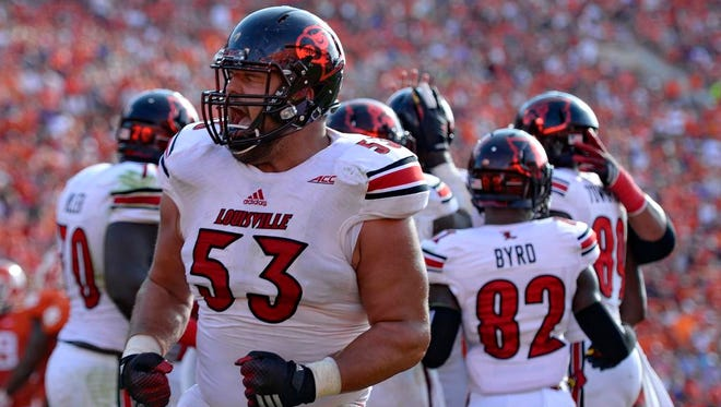 Louisvile's Jake Smith celebrates after the Cardinals scored a first half touchdown during an NCAA college football game against Clemson in Clemson, S.C.,  Saturday, Oct. 11, 2014.  (AP Photo/ Richard Shiro)