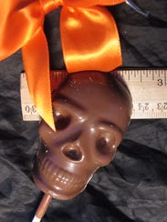 Grinning milk chocolate skull, made by Bissinger's