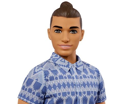 A broad body-style made-over Ken doll by Mattel.