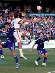 Louisville City's FC's Andrew Lubahn keeps his eye on the ball as it comes off of a header. June 25, 2016
