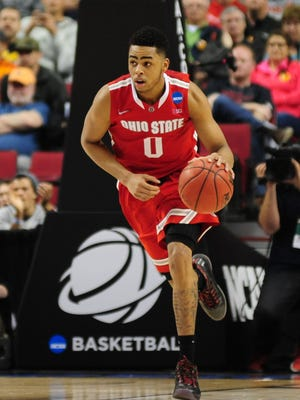 Ohio State Buckeyes guard D'Angelo Russell (0) dribbles against the Virginia Commonwealth Rams during the second half in the second round of the 2015 NCAA Tournament at Moda Center.