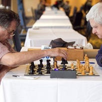 Ed Mandell and Roger Blaine play a game during the Great Lakes Chess Open at McCamly Plaza Friday evening.