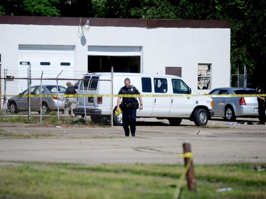Police gather evidence Thursday morning from there shooting in the 500 block of Seneca.