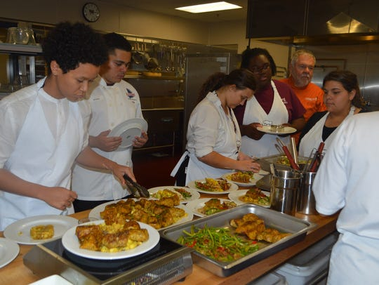 Culinary students practice their plating finesse.