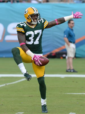 Green Bay Packers cornerback Sam Shields (37) dances in celebration after intercepting a Ryan Tannehill pass against the Miami Dolphins at Sun Life Stadium.