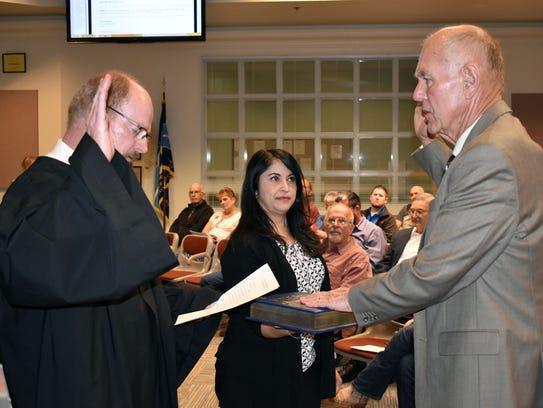 Mayor Richard Boss is sworn into office by Judge Steve