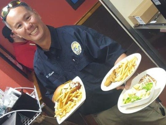 Fort Pierce Police Officer Damian Spotts gets ready
