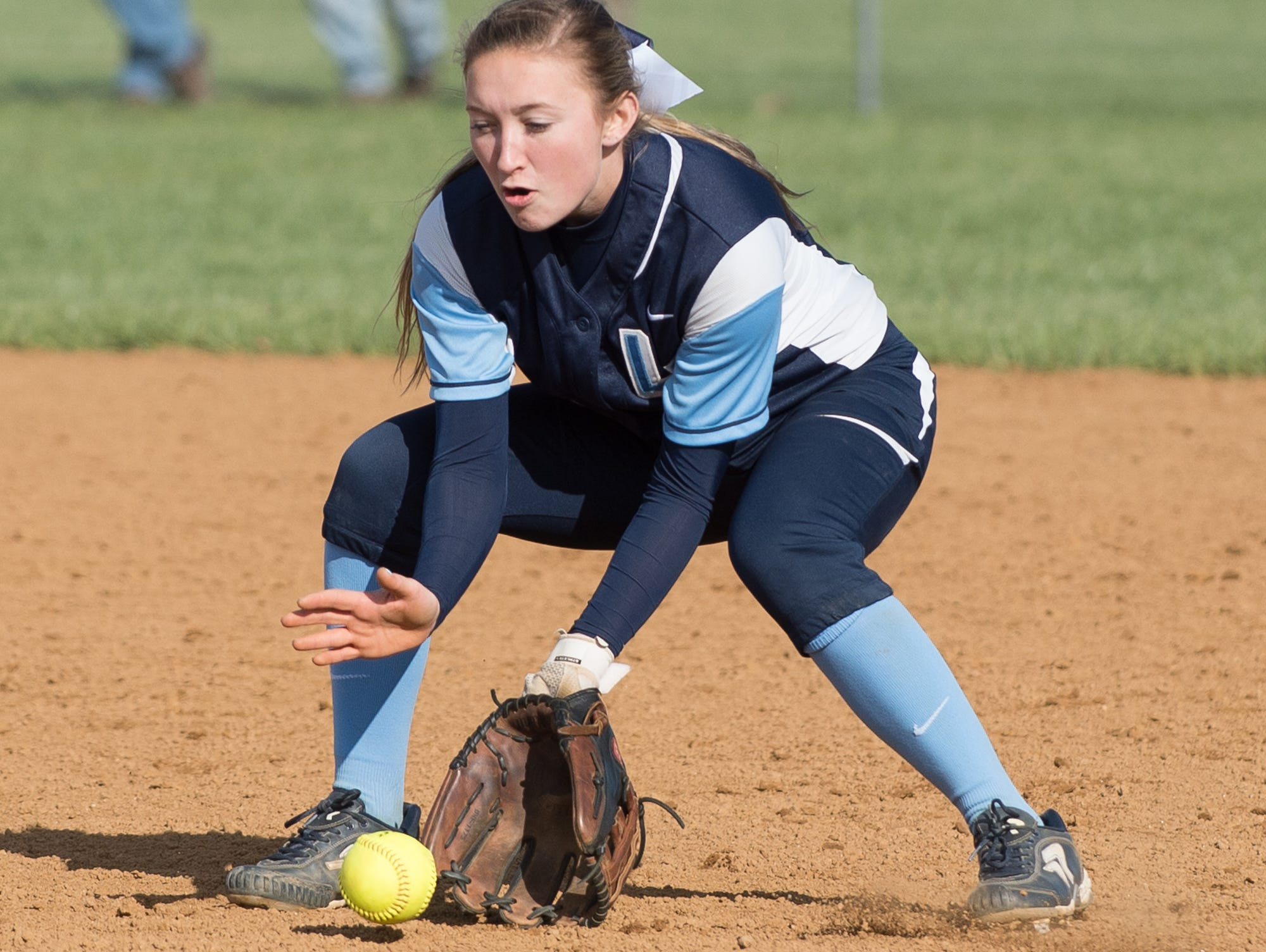 Lake Forest's Kaitlyn Stahre (4) catches a ground ball in their win over Red Lion.