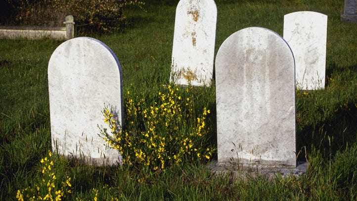 Stock image of grave markers in cemetery.