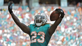 Miami Dolphins running back Jay Ajayi celebrates after scoring a touchdown against the Buffalo Bills.