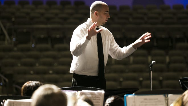 Shadow Mountain's band director Natan Simon instructs his band as they practice before a fundraising show at Shadow Mountain High School on May 9, 2016 in Phoenix, Ariz. The Shadow Mountain High School band has been invited to perform for the 75th anniversary of Pearl Harbor, representing Arizona and the USS Arizona.