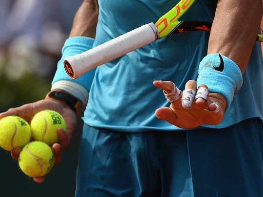 Rafael Nadal overcame cramping in his left hand late
