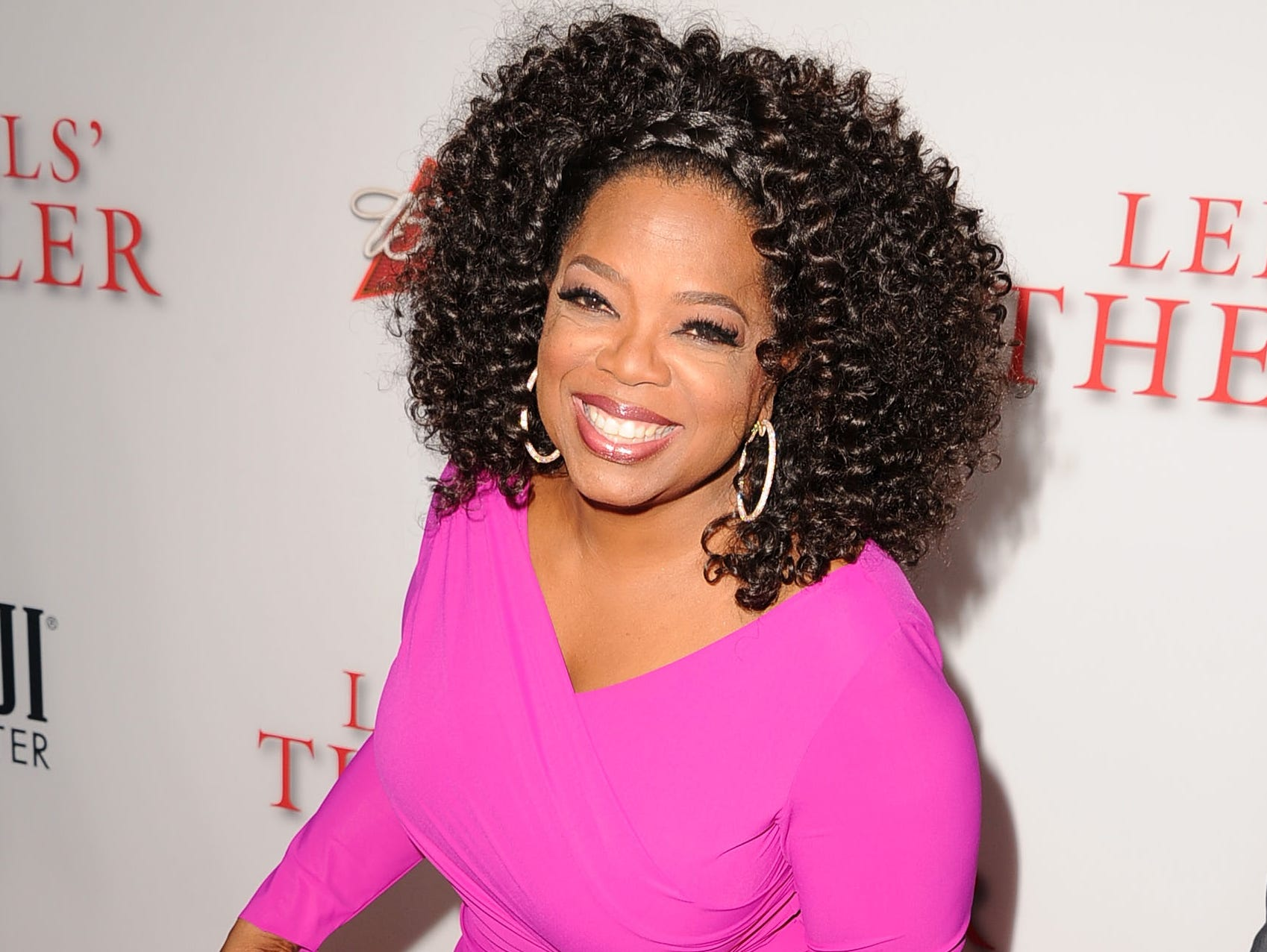 Oprah shows off her curves in a bright pink figure-hugging dress at the film's L.A. premiere on Aug. 12. Her megawatt smile and voluminous curls are the perfect accessories.