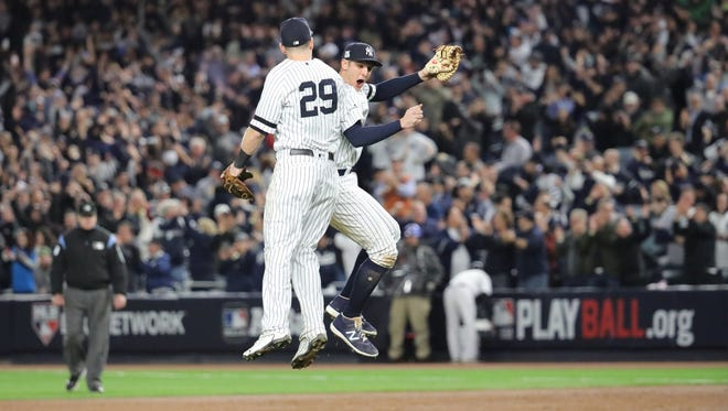 Todd Frazier (29) and Greg Bird celebrate the Yankees 6-4 victory of the Astros in Game 4, Tuesday, October 17, 2017.