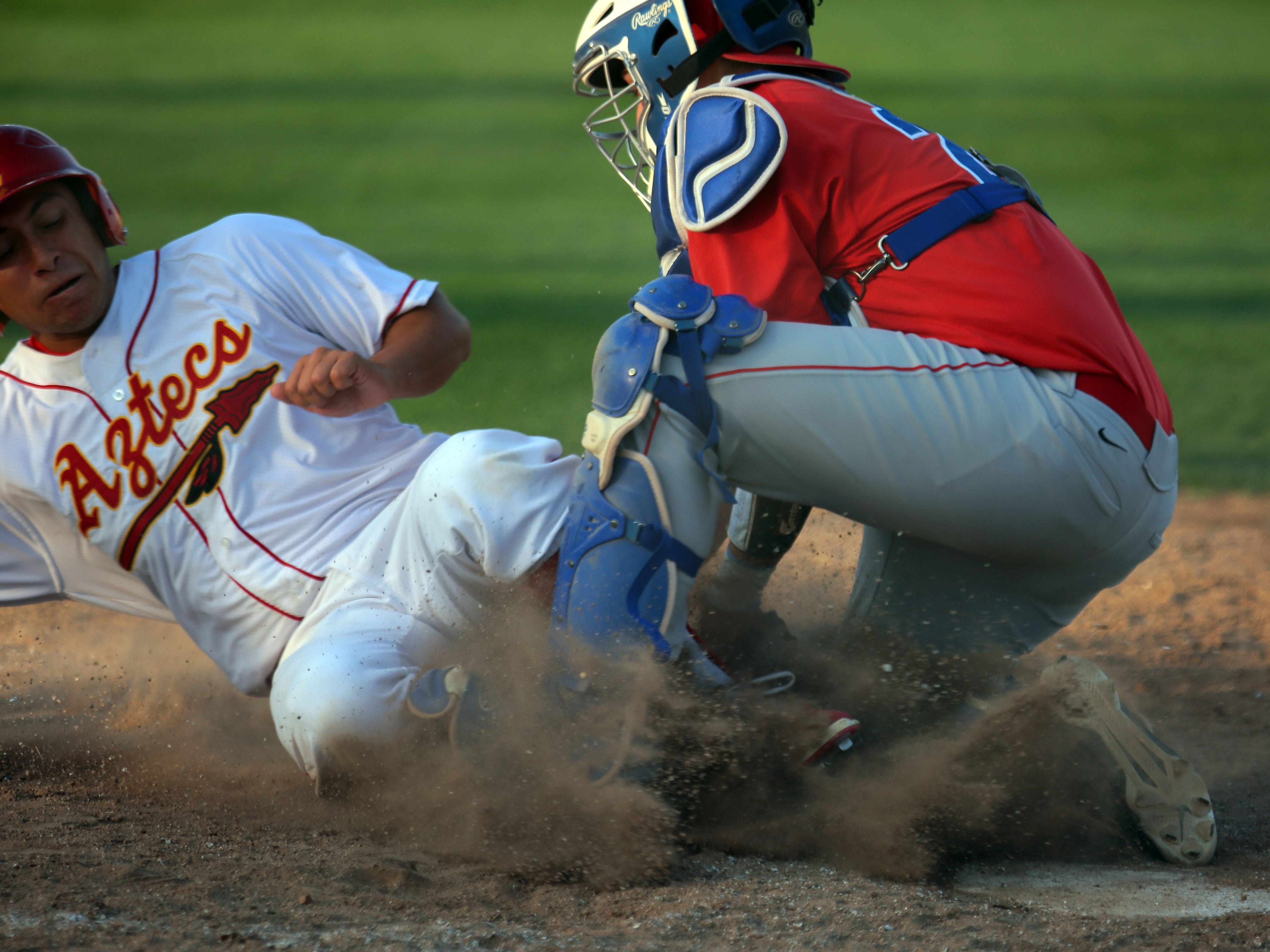 Palm Desert's Gil Sauceda slides safely into home as the ball reaches Indio catcher Steven Lopez in the first inning on Tuesday in Palm Desert.